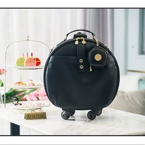 Smart Buddy Vegan Leather Round  carry on luggage
